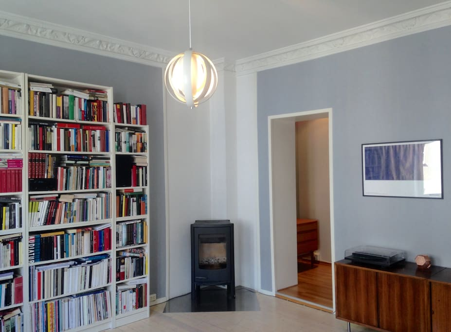 The living room has a cozy fireplace for use in the autumn and winter