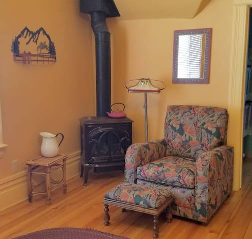 Parlor stove with comfy reading chair