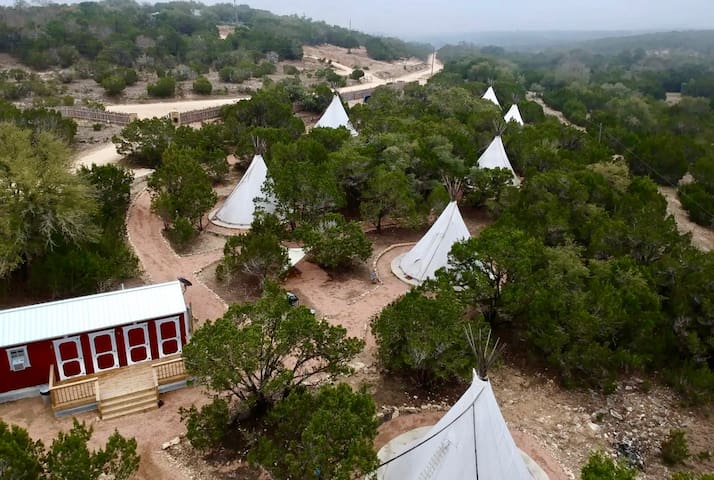 Aerial view of some of our tipis and bathhouse