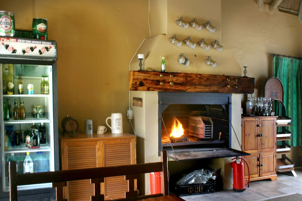 Entertainment photo 1 - Indoor braai/bar area. Big drinks fridge and television for sport