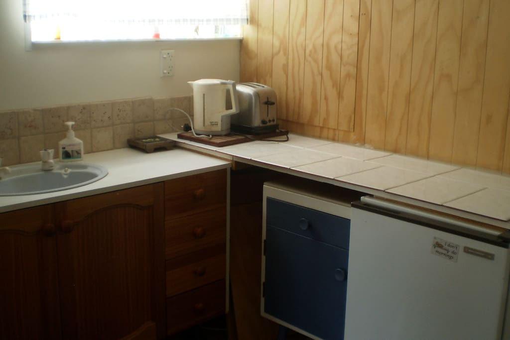 Kitchenette with cooking facilities, fridge, toaster, kettle, crockery/cutlery