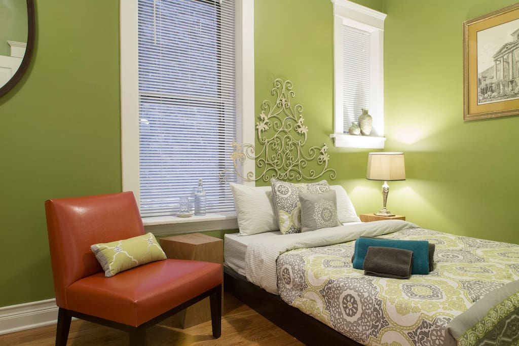 One of three bedrooms with a full-sized bed that sleeps one or two comfortably.