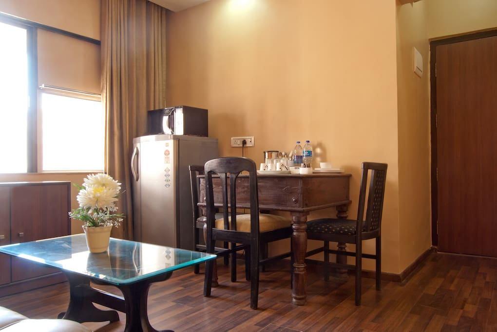 Dining area with refrigerator, microwave & electric kettle. Main entrance to apt on right