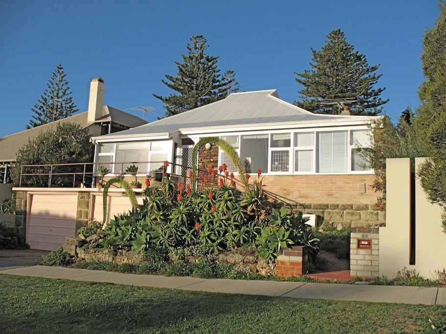 A traditional beach house with attached holiday flat (3 windows on right) in quiet surrounds.