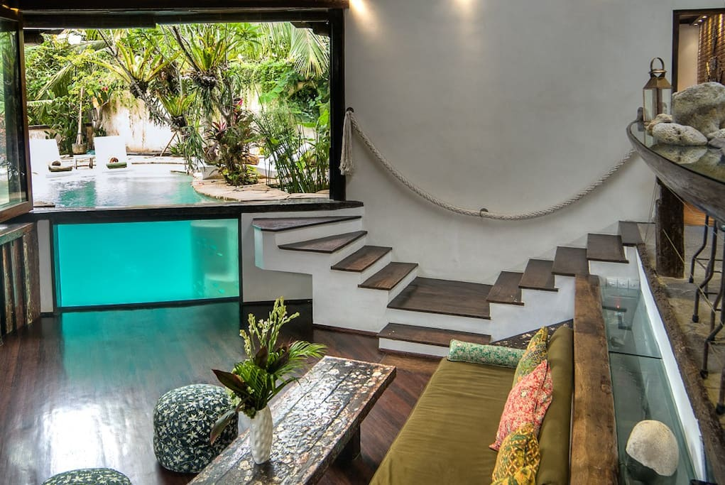 Living room and views into and onto the private pool.
