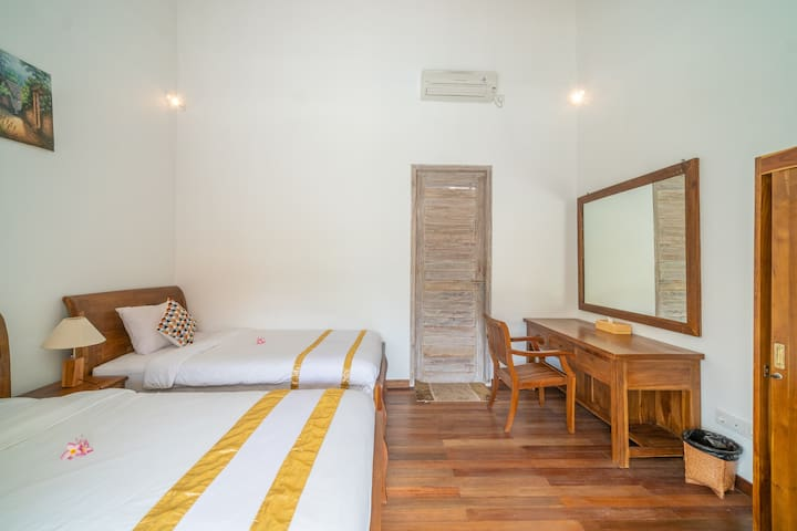Enjoy your private bedroom, equipped with a comfy twin beds, AC, work desk, and a wardrobe
