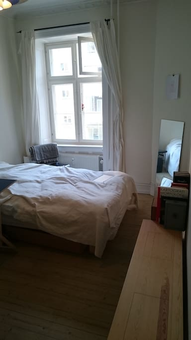 12 sqm. room with desk, bench, closet, bed and chairs.
