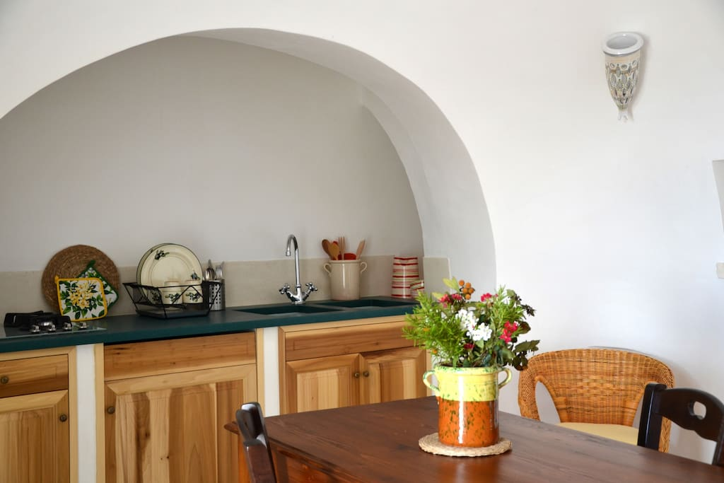 The fully working kitchen under the alcove.