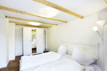 The second separated bedroom for 4 people with double bed on the first floor and mezzanine bed on the second floor