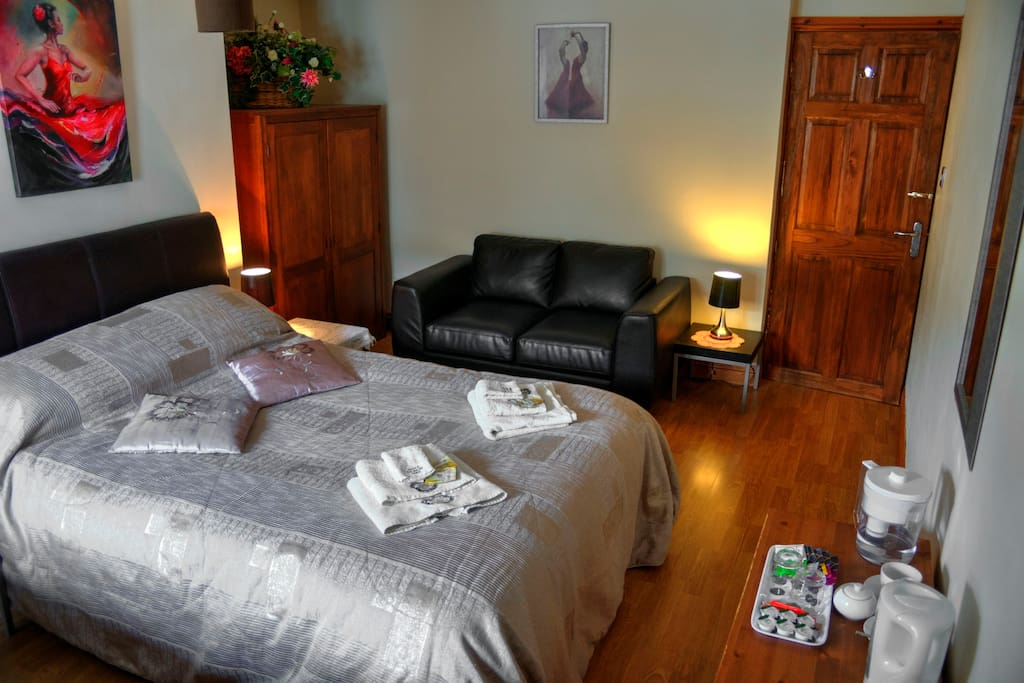 large, bright and comfortable room with double and single bed, tea & coffee