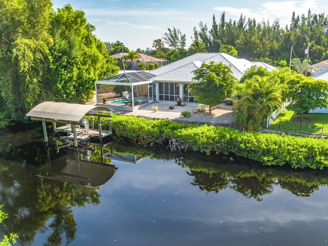 Fish off the backyard dock at this Bokeelia canal home.
