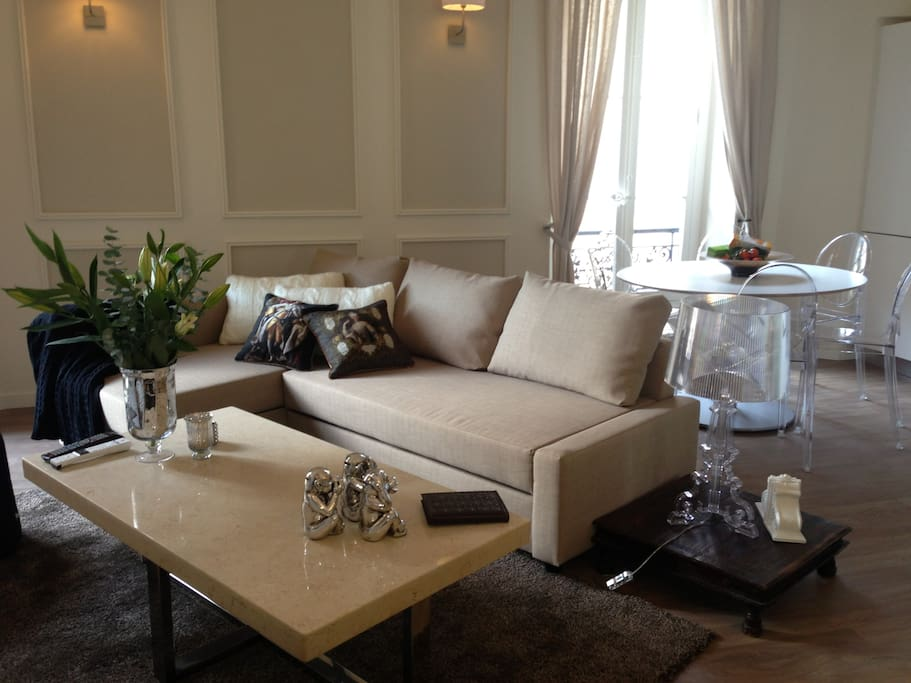lounge,tv, dining room with views of the sea and port of cannes of 3 bedroom apartment..