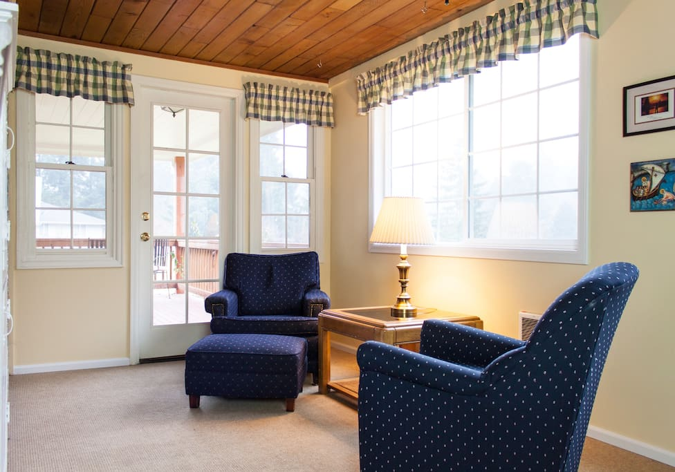The double guest room's reading nook.  The southern exposure gives it lots of great light, and a ceiling fan keeps it cool in the summer.  Note the private entrance which leads onto the wrap-around porch.