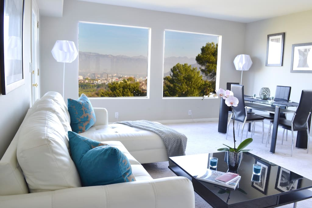 CITY AND MOUNTAIN VIEW FROM MODERN LIVING ROOM