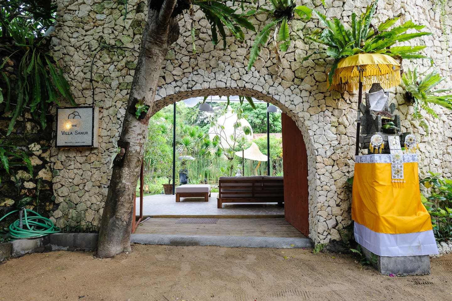 The entrance. At the end of a quiet shady lane is The Villa Sanur.
