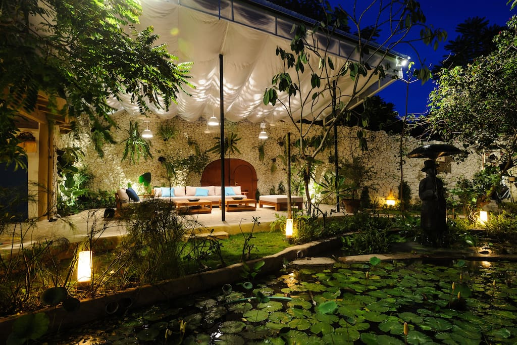 The main outdoor living space, surrounded by garden.