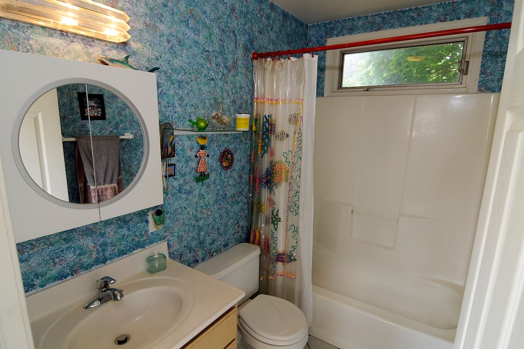 The full bath is in the hall a few steps away. It may be shared with only one other room.