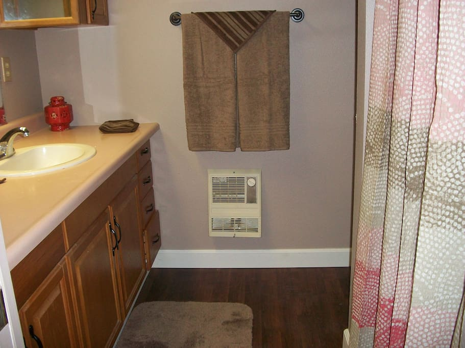 Private bathroom with sink, commode & shower. Stocked with basic bathroom amenities.