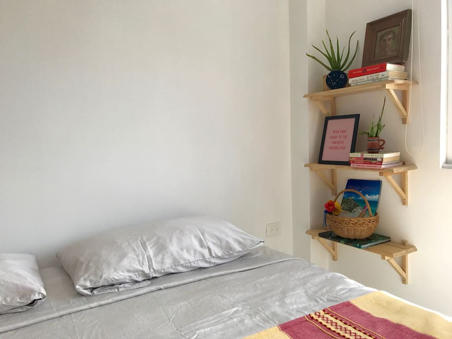 Super comfy king size bed with pretty deco and books you can borrow during your stay.