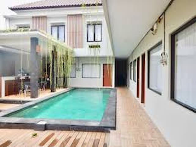 Cozy room near with airport and kuta beach.