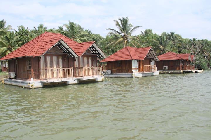 Floating cottages on Poovar Island