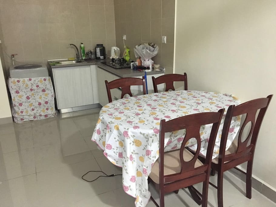 Loveable kitchen with access to fridge, washing machine, and cooking equipments