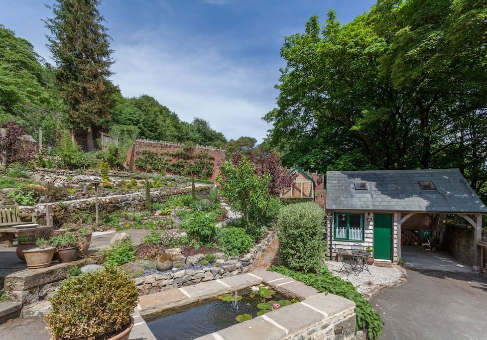 The garden house is set in the walled garden of an Edwardian villa