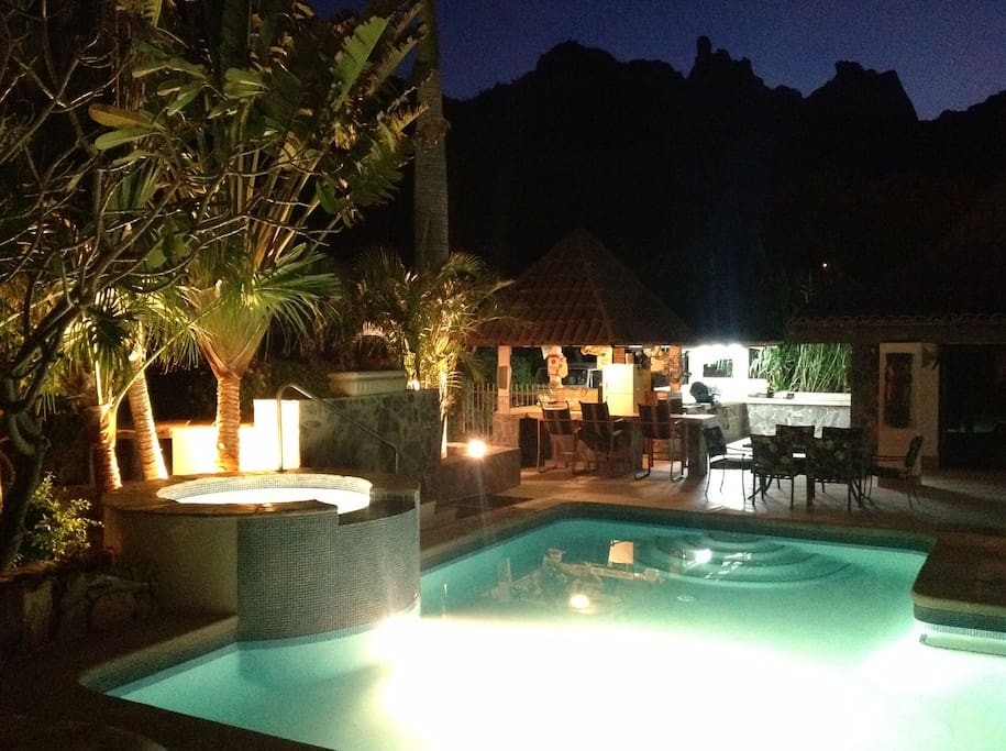 Casa Margarita is located where the Sonora Mountains meet the Sea of Cortez.  This sunset picture is of our pool & hot tub, Tiki bar and outdoor cooking and dining area. Choose either gas or charcoal grills.