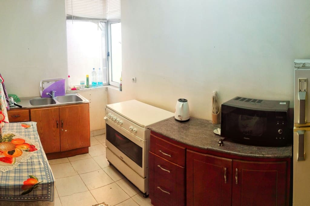kitchen with stove microwave & refrigerator