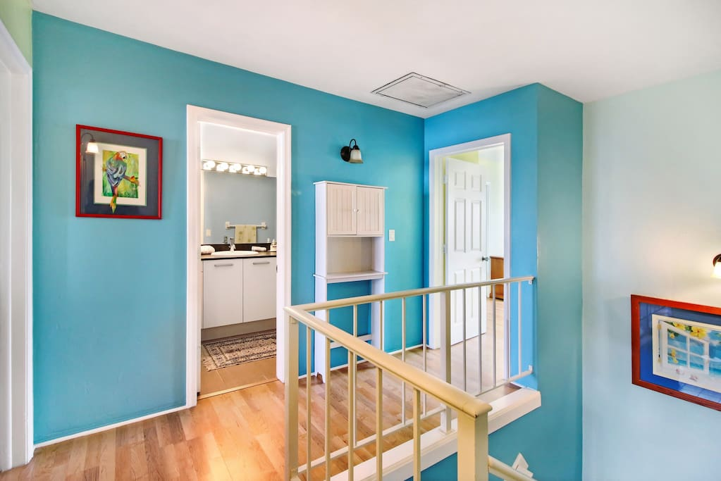 Beautiful carpeted staircase leads upstairs to hall and 2bedrooms and full bath with a bathtub and plenty of cabinet space in our redecorated vanity