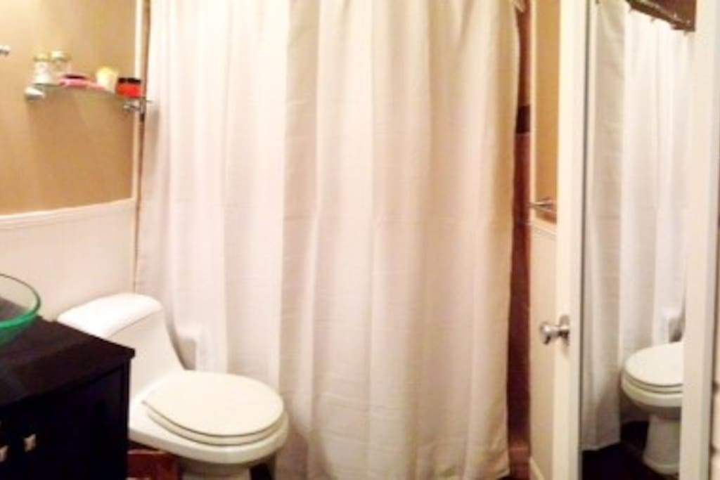 Clean, modern bathroom with shower -- not tub.