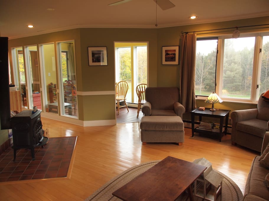 Living room and sunroom, facing south.