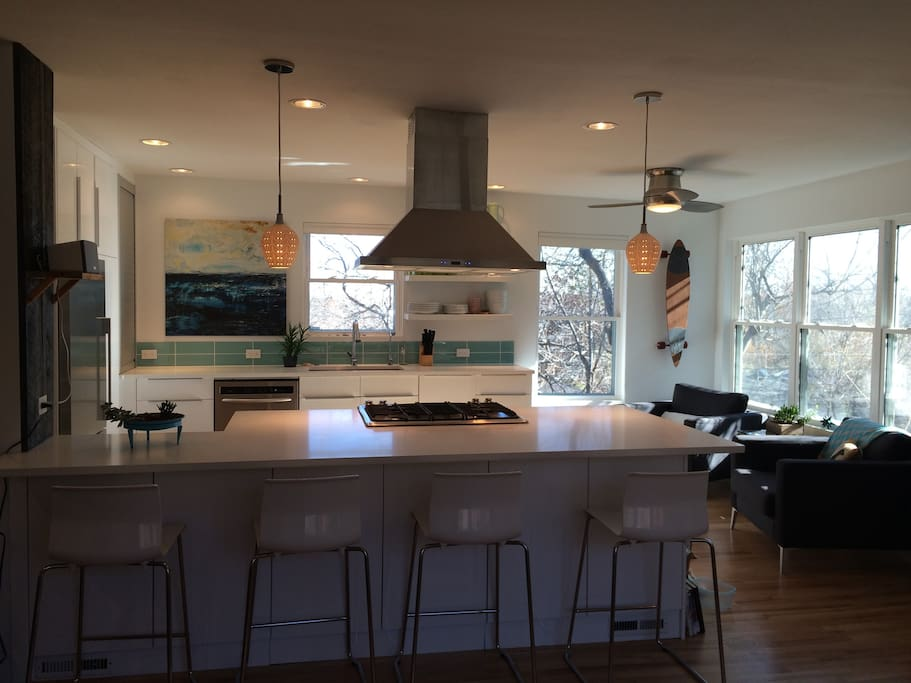 Kitchen designed for cooking and socializing with pals.