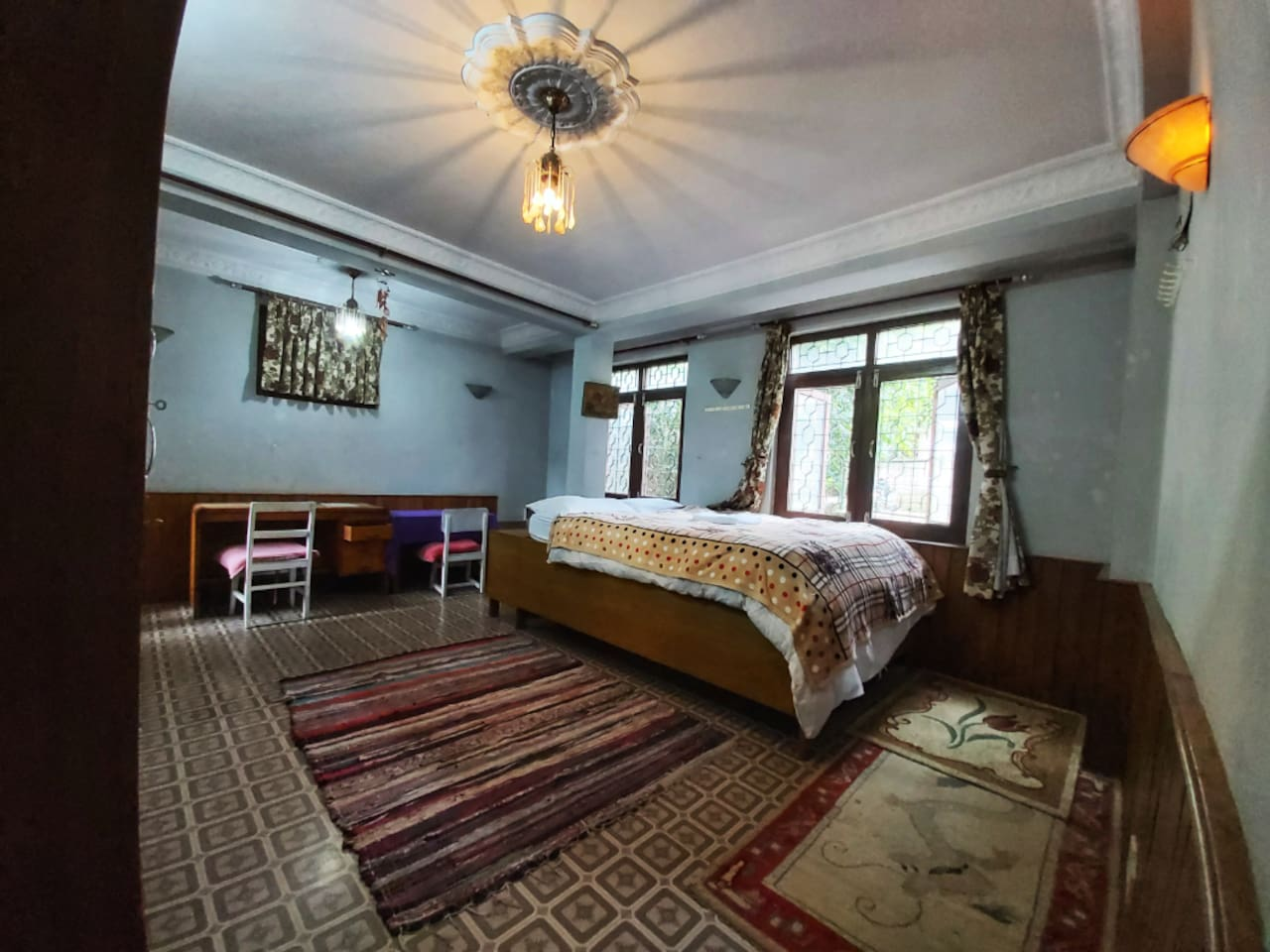 Bright bedroom with queensized bed, closet and study desk with huge windows.
