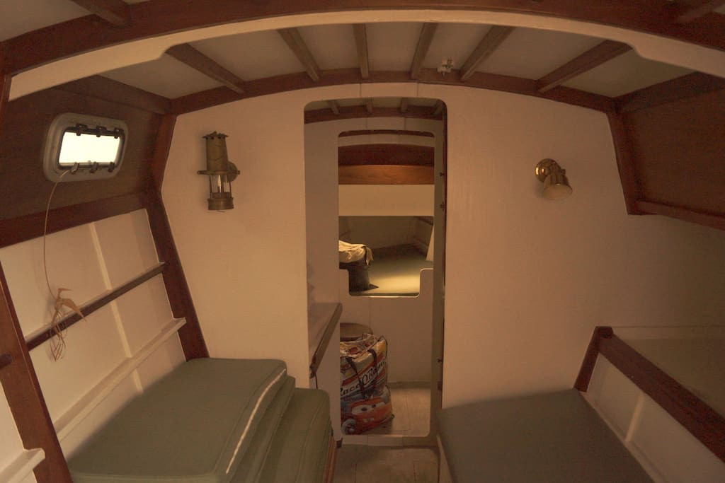 King size bed foreground and twin bunk in back.