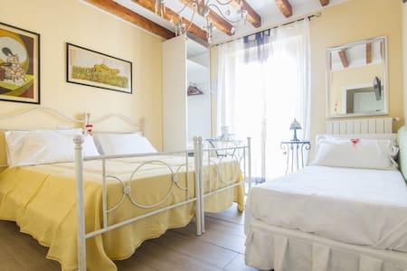camera tripla con letto matrimoniale + singolo