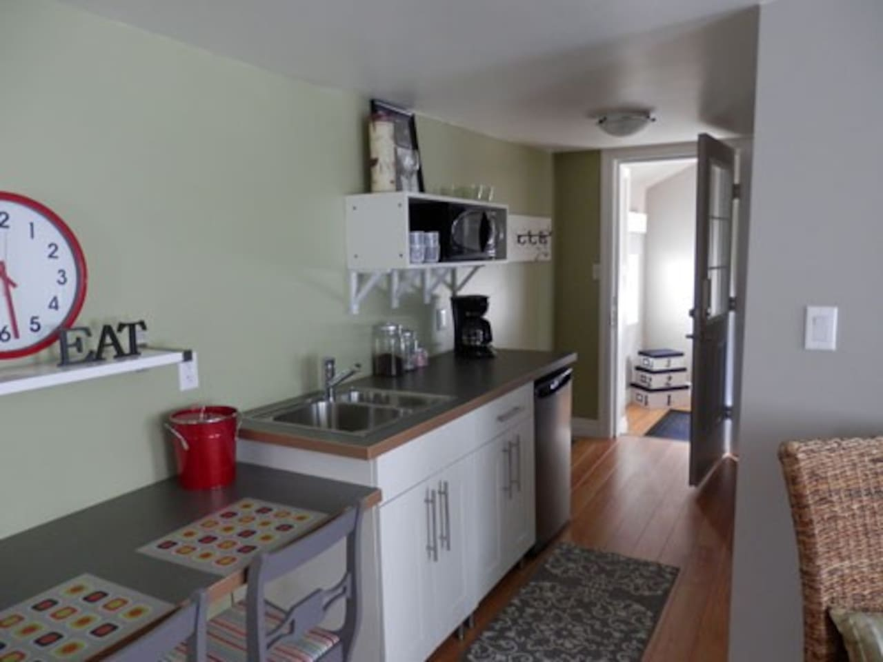 Convenience kitchen with microwave, fridge, 2 person eating bar.