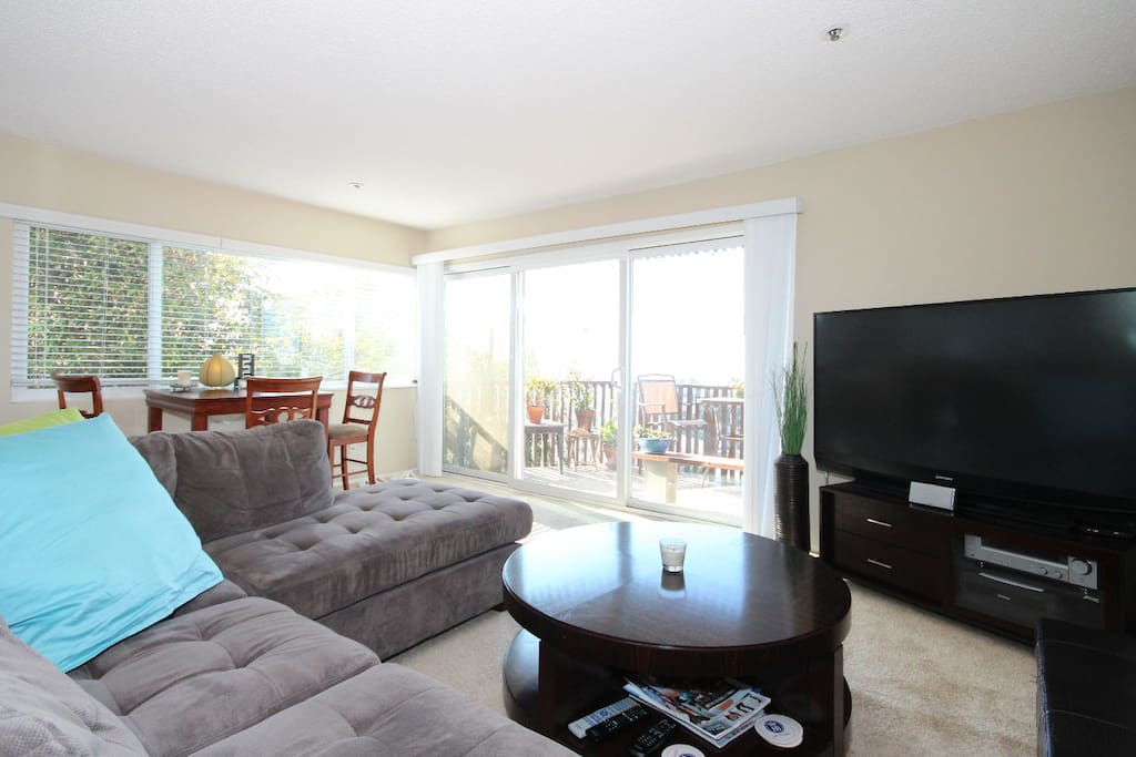 Sunny corner apartment with a comfortable living space.