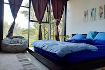 1st (master) bedroom with super king bed and a view to valley and citylight