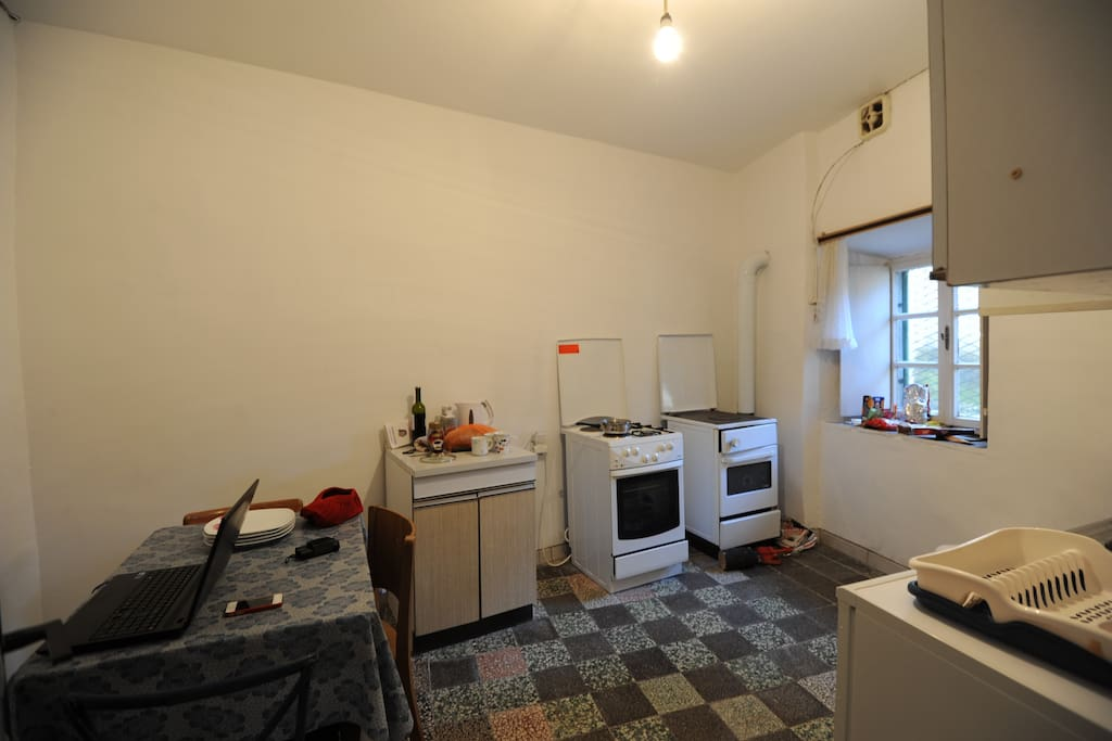 Basic kitchen facilities with electric hob and fridge.