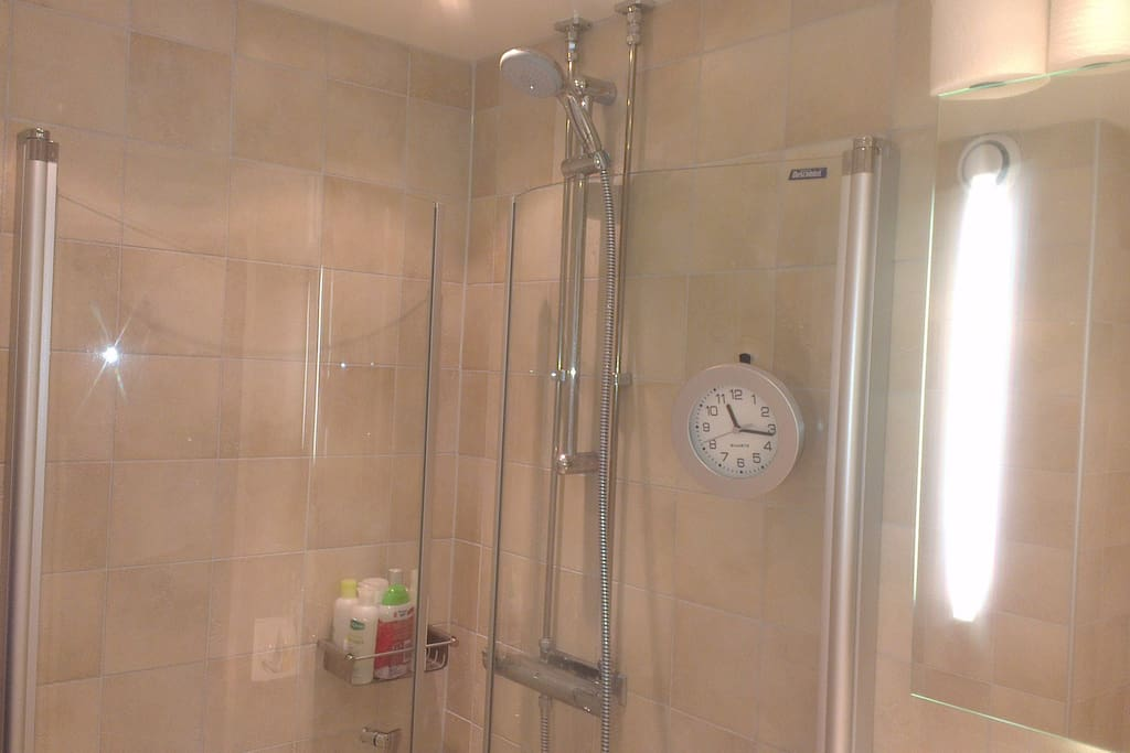 Well kept bathroom with shower and heated tiled floor.