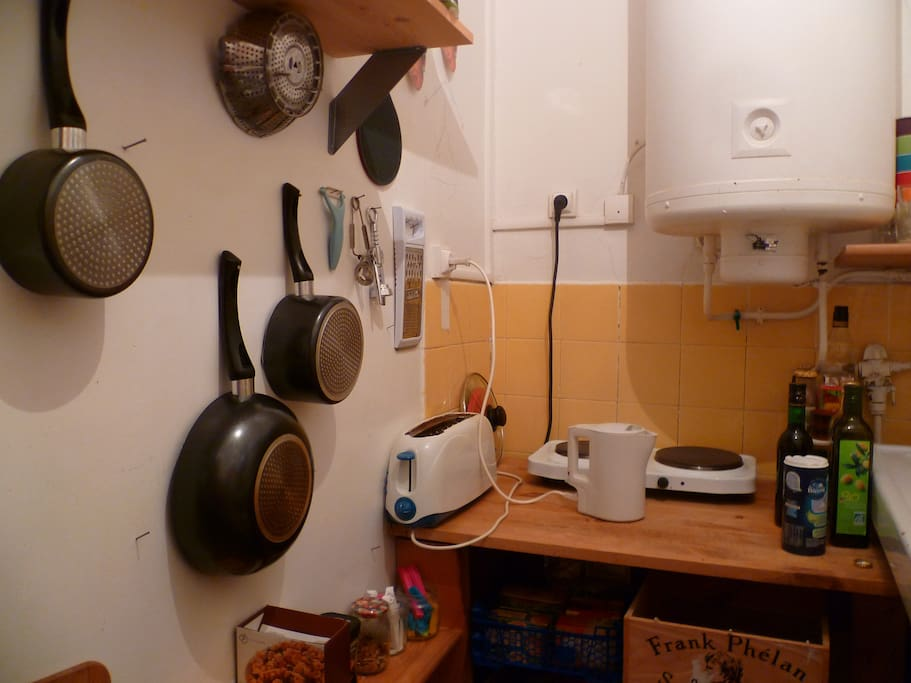 kitchen with hoven, waching machine, fridge, plates, cooking stuffs... everythings you need