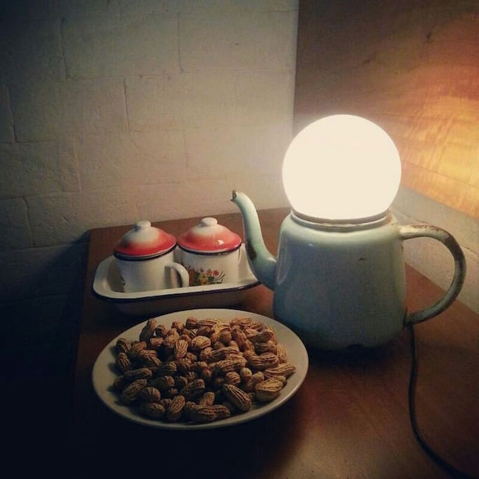 old cup and lamp teapot
