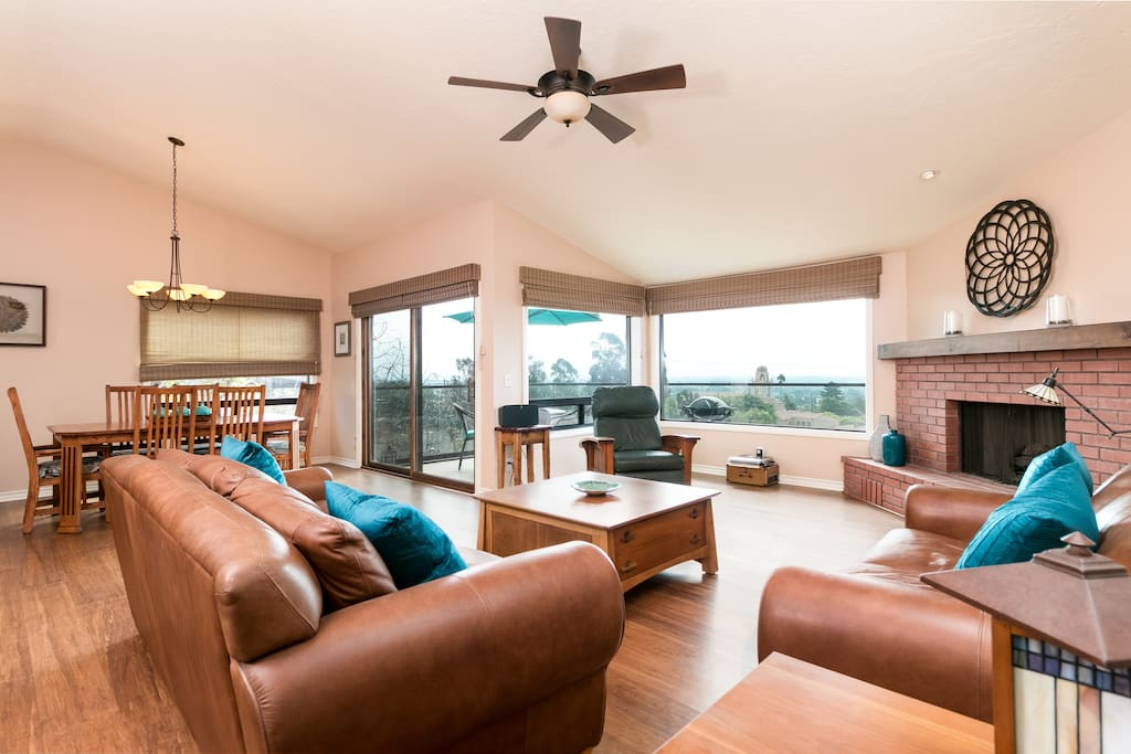 The main living area is light and bright with leather seating and a gas fireplace
