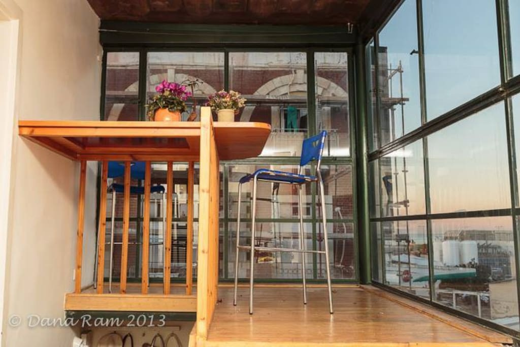 The terrace with sea view by the kitchen. Great spot for your morning coffee