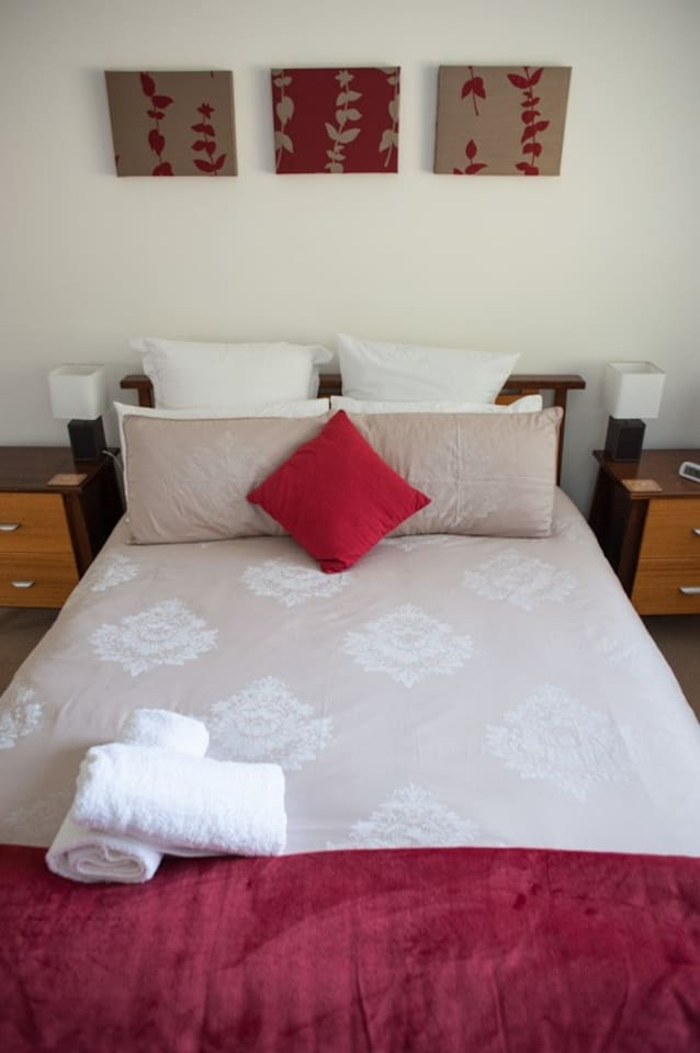 Comfortable queen sized bed with fresh linen.
