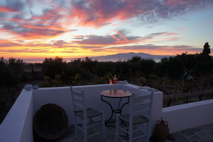 Sip a glass of chilled house rosé as the sun sets over the neighbouring island of Paros