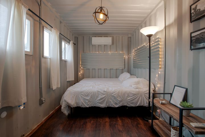 An inside look at the guest house shipping container sleeping arrangement.