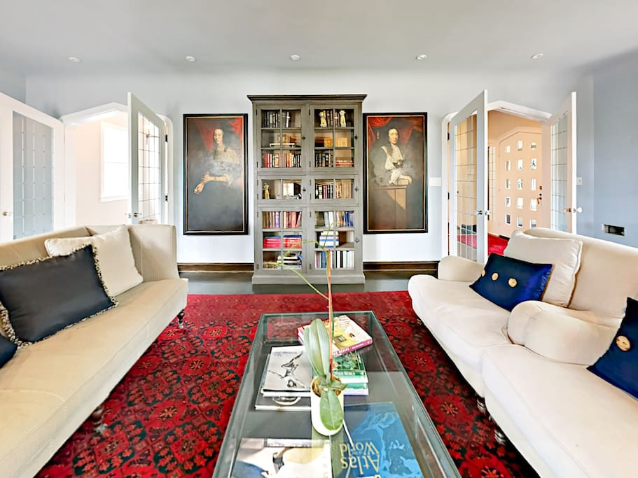 The sunlit living space has captivating artwork and fine furnishings.