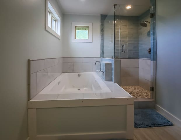 """""""The jacuzzi is exactly what you need after a long day of hiking."""" From a guest review.  PHOTO: Master Bath"""
